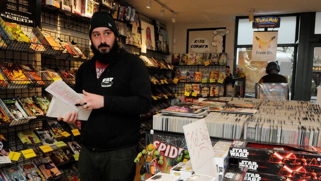Jeff Beck, owner of East Side Comics, checks inventory in his Montclair shop on Tuesday, Jan. 31, 2017. Beck was one of three small-business owners at a news conference on Wednesday sponsored by the New Jersey Main Street Alliance, an advocacy group for small-business owners. They say that repealing the Affordable Care Act without a comparable replacement could hurt 46,000 entrepreneurs and small-business owners who have purchased health insurance under the act.