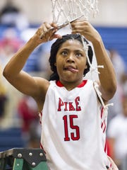 Pike junior Angel Baker (15) cuts down a piece of the