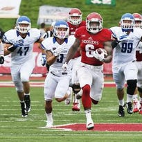Tevin Coleman runs away from Indiana State defenders.