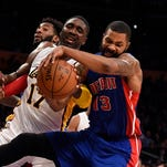 Lakers center Roy Hibbert (17) and Pistons forward Marcus Morris (13) go for a rebound during the second quarter of the Pistons' loss Sunday in Los Angeles.