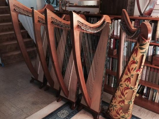 Shown are the five Celtic floor harps donated to Candace Coates' youth harp program by Peter Reis, president of Harps International.