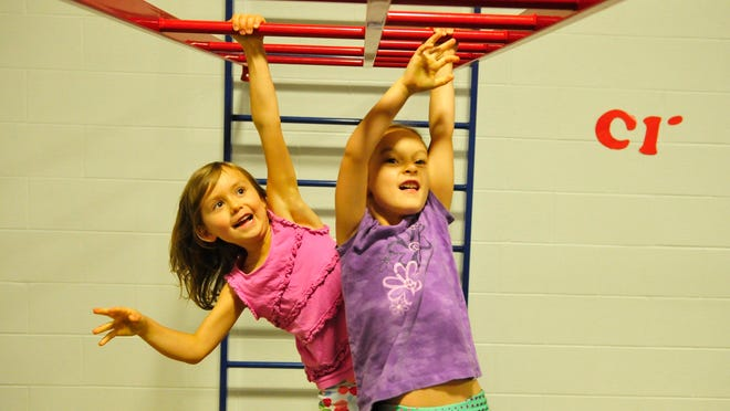 """Moore Elementary School kindergarteners June Solberg, left, and Marley Lawrence exercise every school day in a program called """"Ready K."""""""