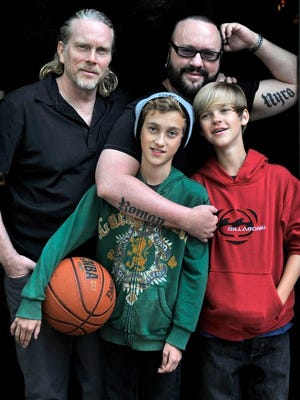 To celebrate his 60th birthday, Nashville songwriter Desmond Child, top right, got tattoos of his boys' names. He wanted ink that was meaningful, and there is nothing more significant than his relationship with longtime partner Curtis Shaw, top left, and their twin boys, Roman and Nyro.