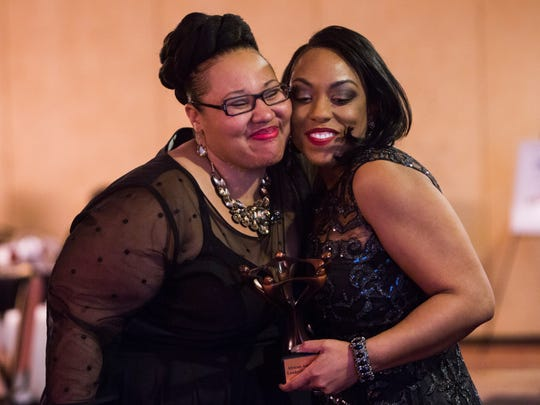 Laneika Musalini, founder and president of the nonprofit Women's Empowerment, hugs Shaka Smith on Friday as she receives the Community Trailblazer Award at the first Black History Black Tie Ball in Anderson.