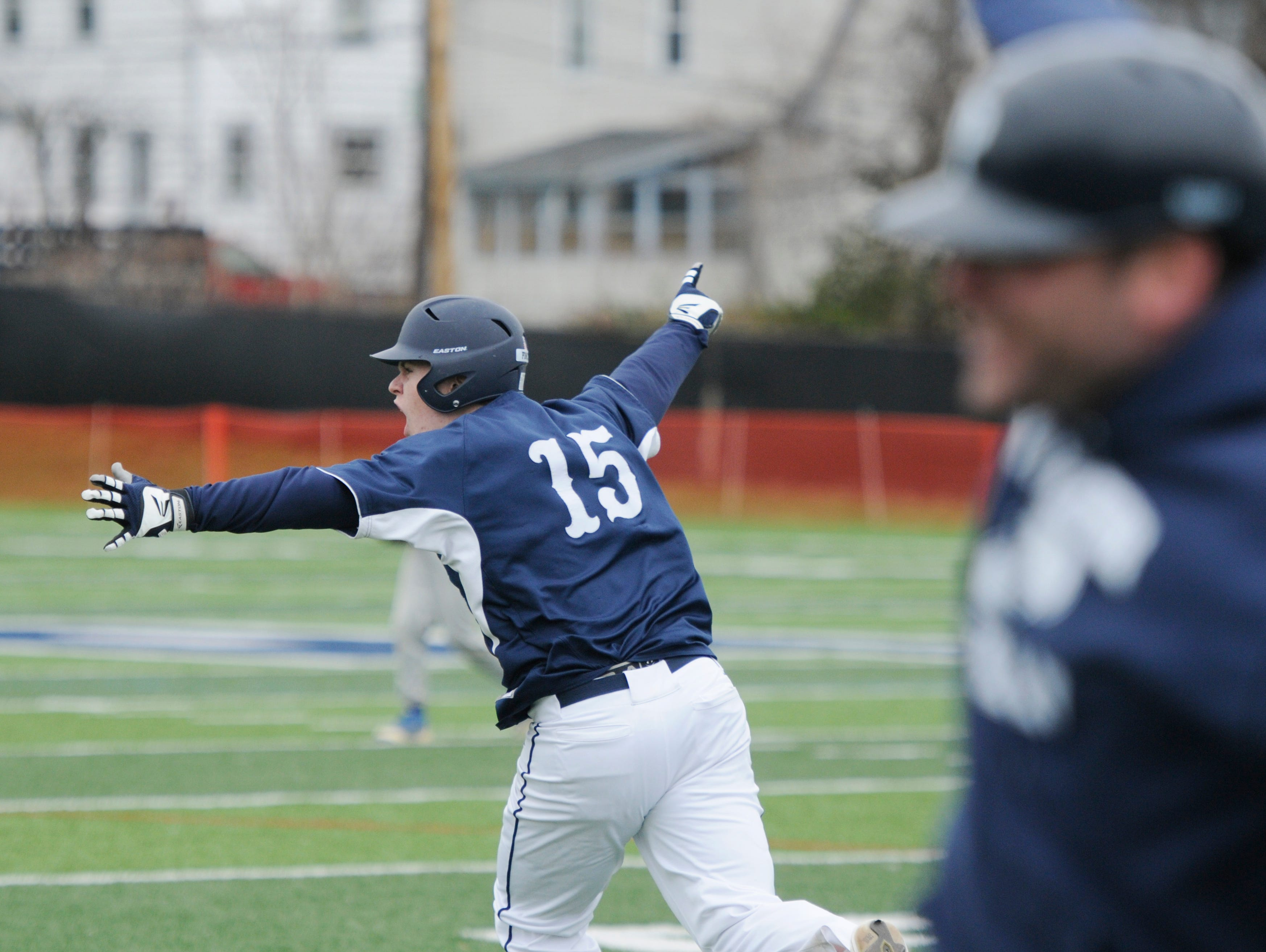 Poughkeepsie's Cullen O'Shea celebrates hitting a grand slam home run in the sixth inning of Saturday's game versus Rhinebeck at Poughkeepsie High School.