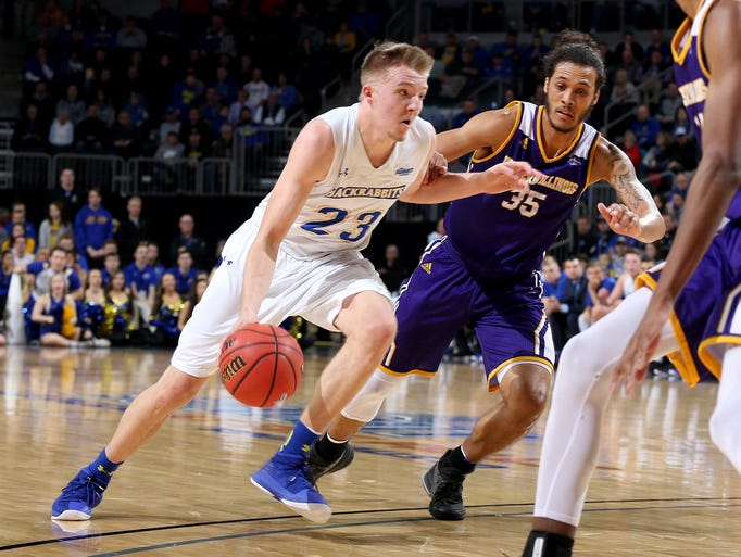 SDSU's Reed Tellinghuisen #23 drives to the hoop and