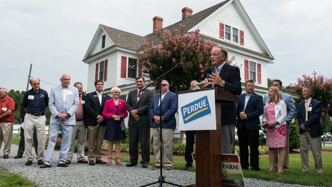 Perdue Farms chairman Jim Perdue speaks to an audience during a ceremony commemorating the 100-year anniversary of the Perdue Family Farmhouse on Monday, Aug. 21, 2017.