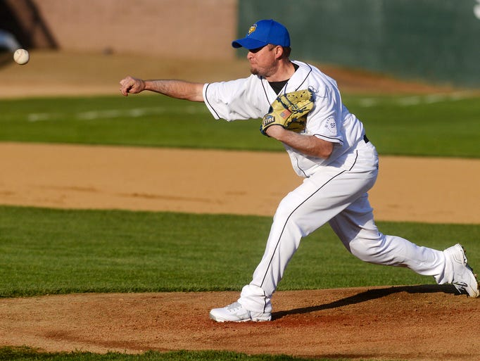 Ben Moore pitches for the Canaries as they play Sioux City in Thursday's season opener at Sioux Falls Stadium, May 15, 2014.