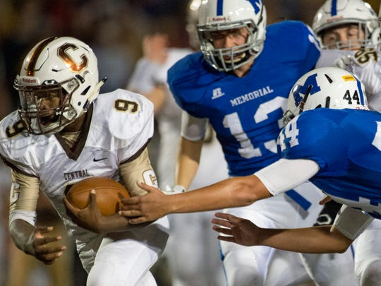 Central's Tor'Jon Evans (9) carries the ball past Memorial's Devon Merimee (44) to score a touchdown against the Memorial Tigers at Enlow Field in Evansville, Ind., on Friday, Sept. 29, 2017. Central won 35-7.