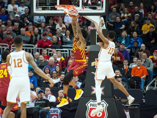 Iowa State Cyclones forward Zoran Talley Jr. (23) dunks the ball after getting past Texas Longhorns guard Jase Febres (13) in the second half during the first round of the Big 12 Tournament on March 7, 2018 at the Sprint Center in Kansas City, Missouri.