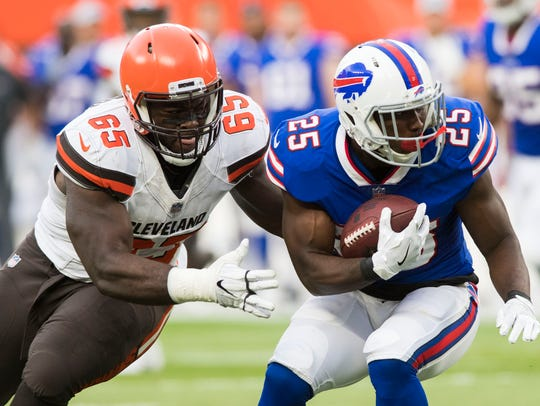 Cleveland Browns defensive tackle Larry Ogunjobi tackles Buffalo Bills running back LeSean McCoy during the first quarter of a preseason game last month.