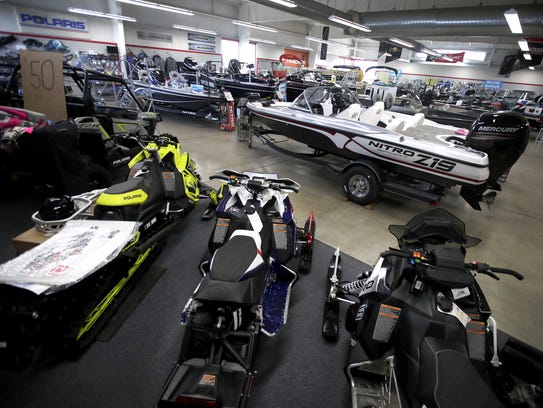 A few snowmobiles were on display Thursday at Sport-o-Motive's showroom in Grand Chute. Sport-O-Motive started filling the showroom with boats roughly a month early because of a lack of snow in the area. Danny Damiani/USA TODAY NETWORK-Wisconsin.