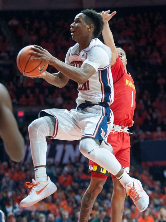 Illinois guard Trent Frazier (1) drives past Maryland guard Anthony Cowan during an NCAA college basketball game in Champaign, Ill., Sunday, Dec. 3, 2017. (AP Photo/Robin Scholz)