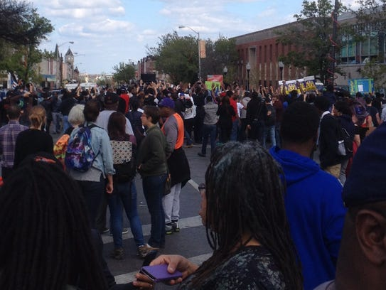 Peaceful protesters rallied Tuesday in Baltimore around