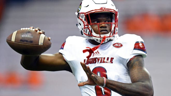 Louisville Cardinals quarterback Lamar Jackson (8) warms up prior to the game against the Syracuse Orange at the Carrier Dome in Syracuse, N.Y., on Sept. 9, 2016.
