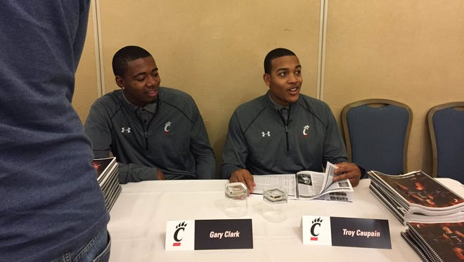 UC point guard Troy Caupain (right) meets with reporters Monday in Philadelphia, shortly after being named AAC preseason Co-Player of the Year. UC forward Gary Clark (left) joined Caupain on the preseason All-AAC first team.