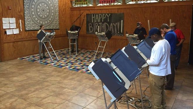 Hattiesburg residents cast their ballots Tuesday at the Kamper Park precinct.