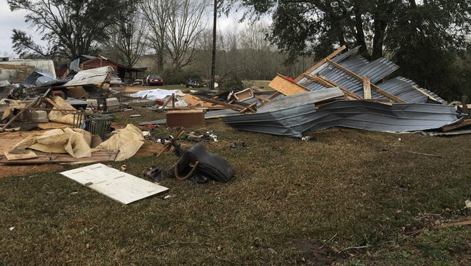 National Weather Service survey team in Scott County, Mississippi after a storm comes through leaving damage.