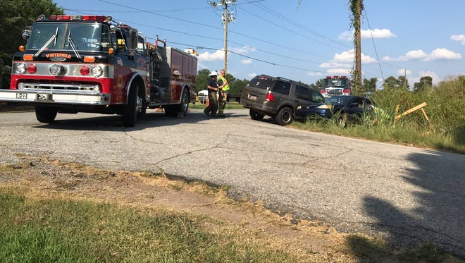 Two vehicles sit in a ditch near a gas line near Williamston at the intersection of Breazeale and Mitchell roads.