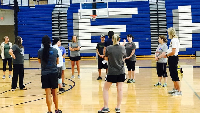 Participants in a SPARK project listen to instruction in preparation for after-school physical activity. MTSU will implement the nationally lauded program in nine elementary schools in four rural Tennessee counties.