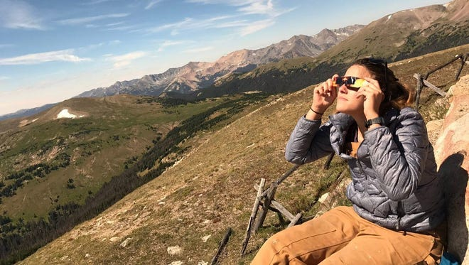 Nick Coltrain/The Coloradoan The Gore Range overlook in Rocky Mountain National Park offered a scenic backdrop for viewing the eclipse. Coloradoan reporter Nick Coltrain watched the eclipse from the Gore Range overlook in Rocky Mountain National Park.