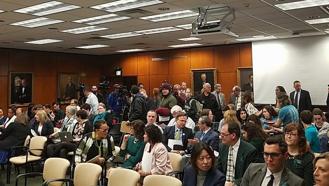 Crowd at the Michigan State Board of Trustees meeting April 13, 2018.