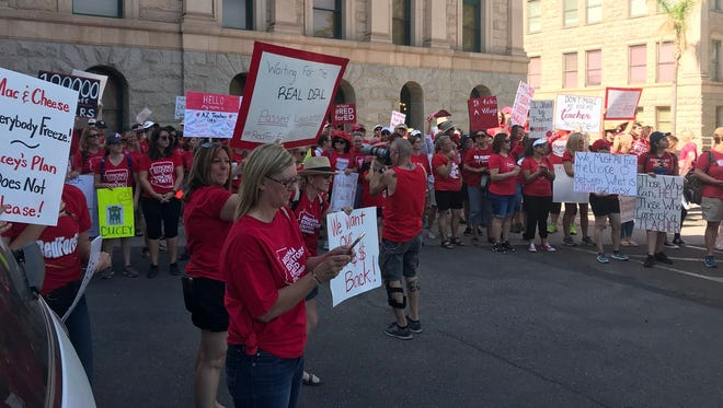 """Crowds are chanting """"Red For Ed"""" as legislators arrive this morning on the third day of the Red4Ed teacher walkout."""