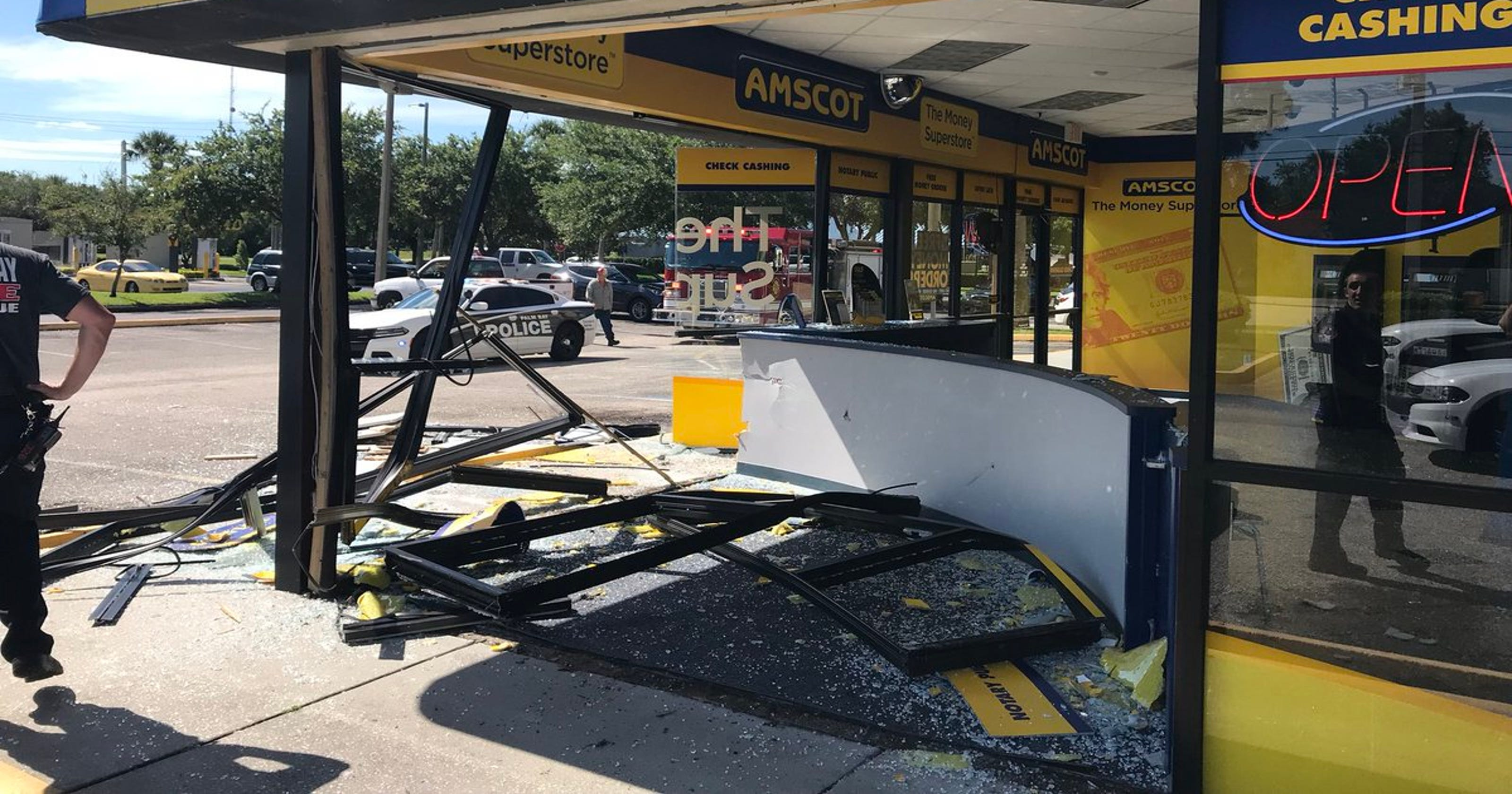Car crashes into Amscot check-cashing business in Palm Bay