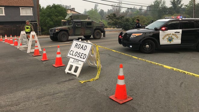 After the Carr Fire struck Redding on July 26, 2018, roadblocks were still in place Tuesday morning, July 31, 2018 to prevent traffic onto Lake Boulevard at Oasis Road.