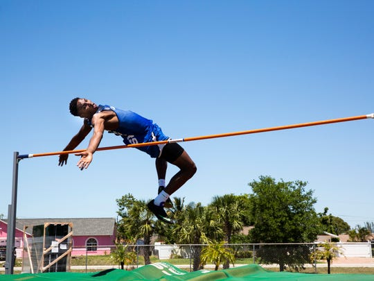 Canterbury's Berrick Jeanlouis competed in the high jump during the Class 1A District 8 track and field meet at St. John Neumann Catholic High School on Tuesday, April 17, 2018, to advance to Regionals.