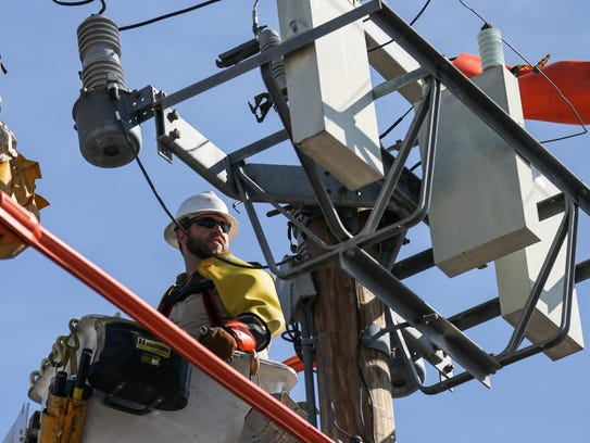 AEP lineworker Danny Lester tests a capacitor bank fuse on April 5.
