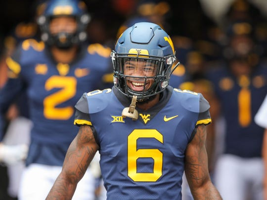 Sep 8, 2018; Morgantown, WV, USA; West Virginia Mountaineers safety Dravon Askew-Henry (6) runs out of the tunnel before their game against the Youngstown State Penguins at Mountaineer Field at Milan Puskar Stadium. Mandatory Credit: Ben Queen-USA TODAY Sports