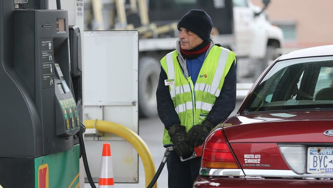 David Ouriel, of Irondequoit,  pumps gas at the full service pumps at Kwik Fill  on East Ridge Road.  He has worked for Kwik Fill for 21 years.
