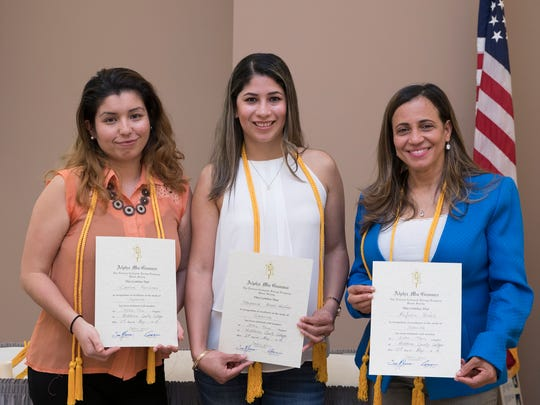 Four students were inducted into the Middlesex County College Chapter of Alpha Mu Gamma, the honor society for foreign language study. Left to right: Caroline Fernández, Stephanie Rossel-Martínez, Rafaela Báez of Edison. Not pictured: Adelainy Bourdier of North Brunswick.