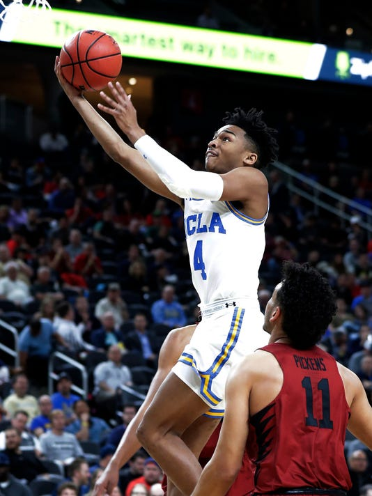 UCLA's Jaylen Hands (4) shoots over Stanford's Dorian Pickens (11) during the first half of an NCAA college basketball game in the quarterfinals of the Pac-12 tournament Thursday, March 8, 2018, in Las Vegas. (AP Photo/Isaac Brekken)