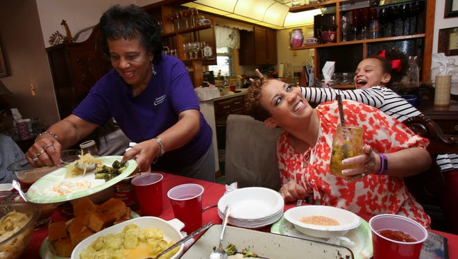 WAVE-3 television anchor Dawne Gee, center, is teased by her granddaughter Addy Gee, 9, as Dawne's mom Joanna Smith prepares a plate during their weekly Sunday meal.  Gee has adopted a vegan lifestyle and dropped almost 40 pounds recently in her effort to battle reoccurrences of cancer.Mar. 20, 2016