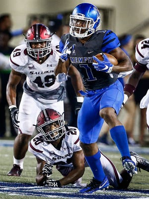University of Memphis returner Tony Pollard (front) brings back a kickoff against the Southern Illinois University defense during first quarter action at the Liberty Bowl Memorial Stadium Saturday, September 23, 2017.