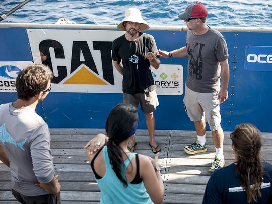 Brazilian scientist Ricardo and Expedition Leader Chris Fischer meet to prep on the shark lift.