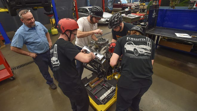 Instructor Bobby Bard watches as his students take apart a car engine inside The Franklin County Career and Technology Center on Tuesday, Dec. 8, 2015 in Chambersburg, Pa. The students haven been practicing in preparation for the PRI Show in Indianapolis.