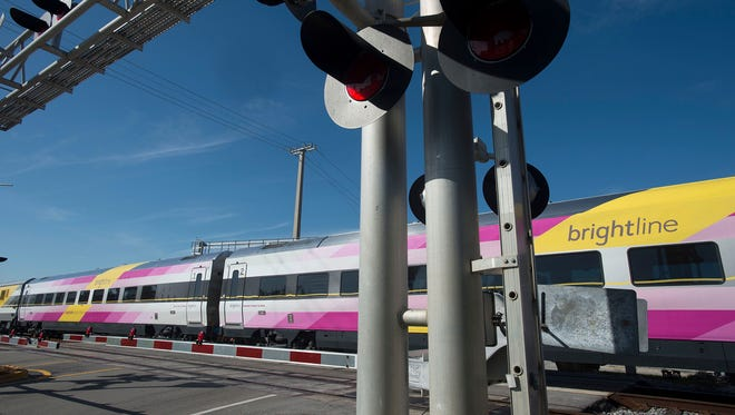 Brightline trains continue service Thursday, Jan. 18, 2018, in Boynton Beach, Fla., shortly after two people were killed by Brightline trains in the same week. A pedestrian was struck and injured Thursday, Feb. 8, 2018, by a Brightline train in Broward County, Fla.