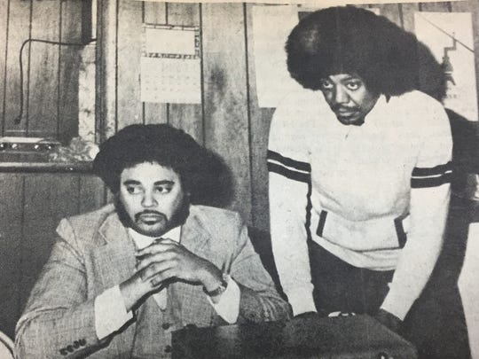 John Johnson, left, president of the Kentucky chapter NAACP and coordinator for the Commission on Human Rights, discusses hiring practices of local coal mines with NAACP president Moscoe Rapier in January 1980.