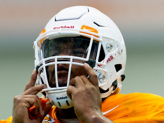 Tennessee's linebacker Darrin Kirkland Jr. (34) puts on his helmet during Tennessee fall football practice at Anderson Training Facility in Knoxville, Tennessee on Friday, August 4, 2017.