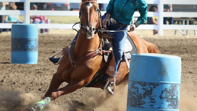 Samantha Lopez competes in a barrel-racing competition during the Polk County Fair on Friday in Rickreall. Samantha Lopez competes in a barrel racing competition during The Polk County Annual Fair in 2015.