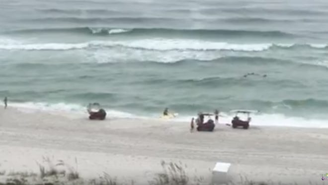 Sheila Tucker of Navarre Beach captured video of Navarre Beach lifeguards saving swimmers from rip currents.