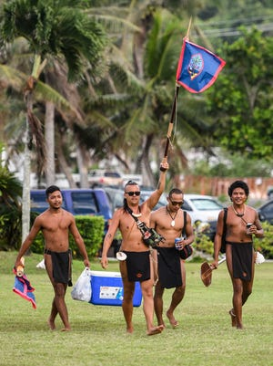Members of traditional seafaring group Ulitao arrive to the Respect the Chamorro People Rally at Adelup on Friday, April 7, 2017.