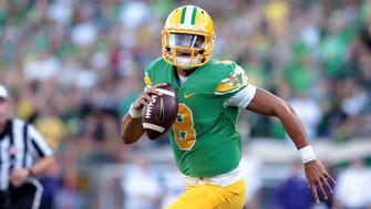 Oregon quarterback Marcus Mariota is one of the two leading contenders for the Heisman, but as it is for both he and Dak Prescott, the wins must keep coming.