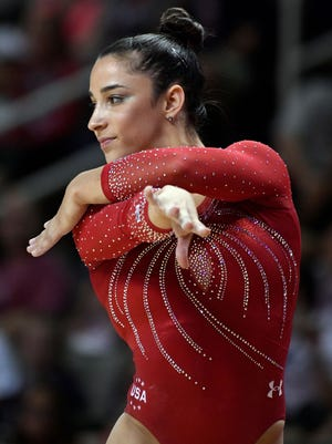 Aly Raisman says she has been trying to trade Olympic pins with the cute boys.