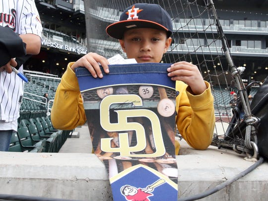 Josiah Navarro, 8, of El Paso waits for autographs