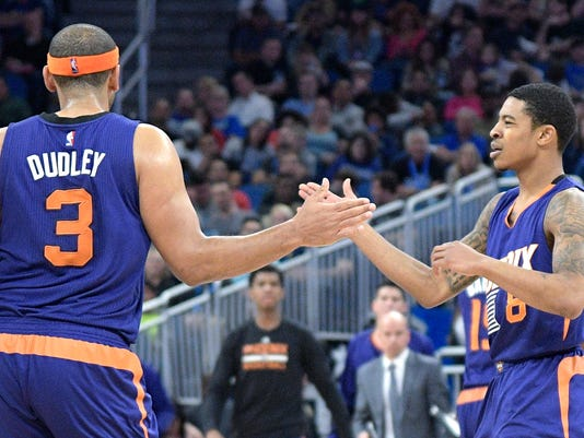 Phoenix Suns guard Tyler Ulis (8) congratulates forward Jared Dudley (3) after scoring a three-point basket during the first half of an NBA basketball game against the Orlando Magic in Orlando, Fla., Wednesday, Nov. 23, 2016. (AP Photo/Phelan M. Ebenhack)