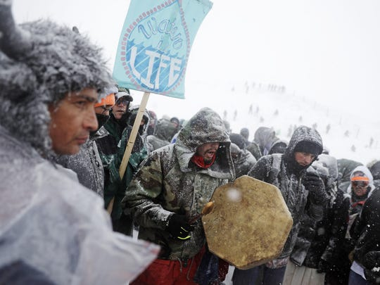 Steven Paul, a Nez Perce Native American from Portland, Ore., drums during a march with military veterans and tribal elders outside the Oceti Sakowin camp where people have gathered to protest the Dakota Access oil pipeline in Cannon Ball, N.D., on Monday.